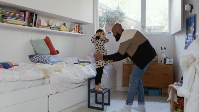 father helping daughter get dressed in bedroom - single father stock videos & royalty-free footage