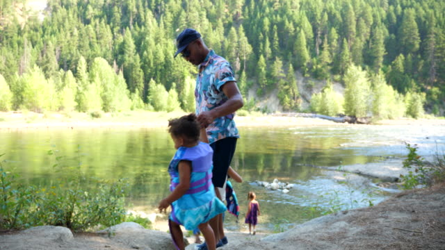 ms father helping daughter walk down to river on summer afternoon - life jacket stock videos & royalty-free footage