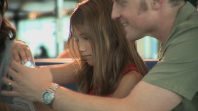 cu father helping daughter (8-9) with camera, appleton, wisconsin, usa - ウィスコンシン州アップルトン点の映像素材/bロール