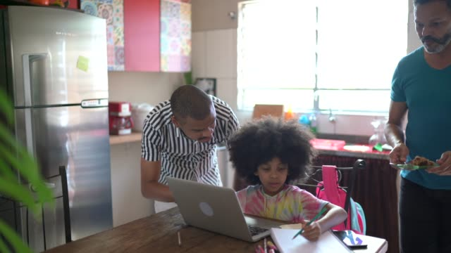father helping daughter with homework at home - modern manhood stock videos & royalty-free footage