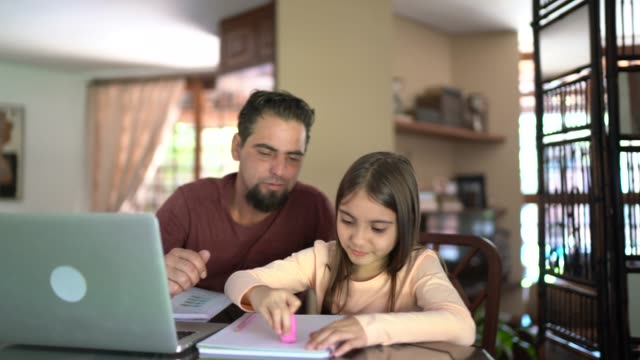 father helping daughter with homework - family with one child stock videos & royalty-free footage