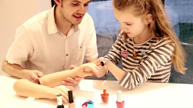 father helping his daughter paint her prosthetic limb nails - prosthetic equipment stock videos & royalty-free footage