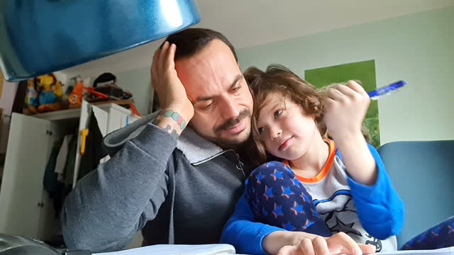 father helping his son doing his homework during the corona lockdown in berlin 2021 - long hair stock videos & royalty-free footage