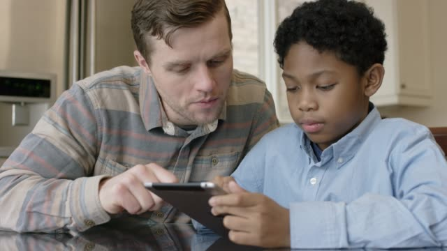 father helping his son with homework - fat camera stock videos and b-roll footage