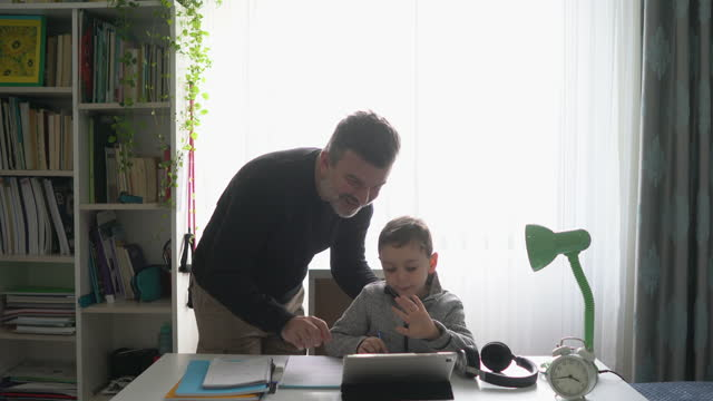 father helping son with homework. - family with one child stock videos & royalty-free footage