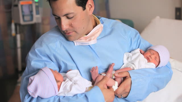 ms father holding and looking at newborn twins / richmond, virginia, usa - twin stock videos & royalty-free footage