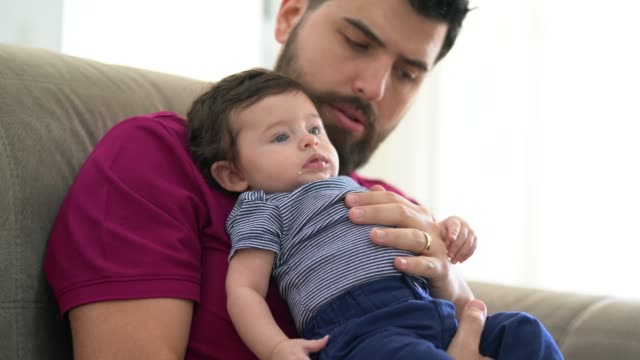 father holding baby son at home - father's day stock videos & royalty-free footage