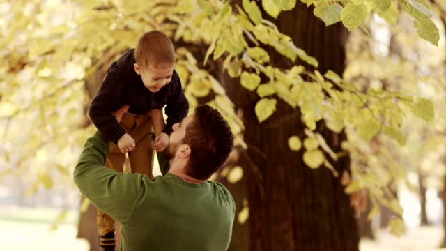 father holding his son - genderblend stock videos & royalty-free footage