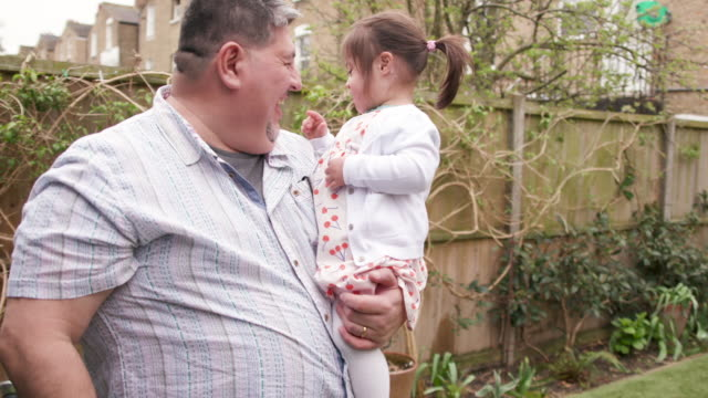a father holding his young daughter with downs syndrome - 45 49 years stock videos & royalty-free footage