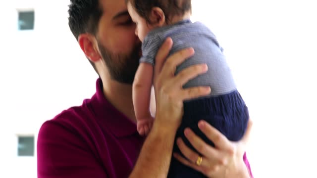 father holding newborn baby son at home - fathers day stock videos & royalty-free footage