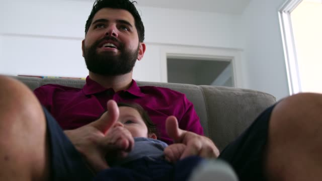 father holding newborn baby son at home - pardo brazilian stock videos & royalty-free footage