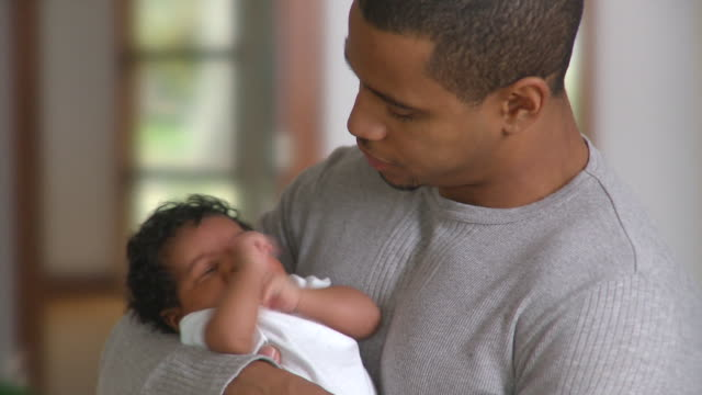 cu father holding newborn girl (0-1 months), richmond, virginia, usa - newborn stock videos & royalty-free footage