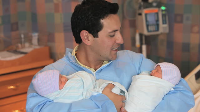 ms father holding newborn twins looking at camera and smiling / richmond, virginia, usa - twin stock videos & royalty-free footage