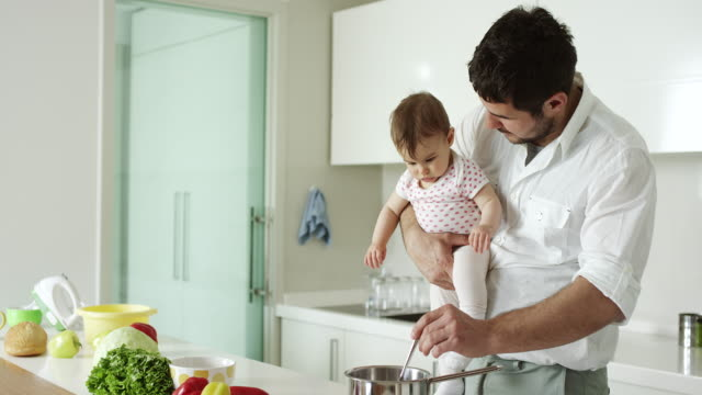 father holding son and cooking - genderblend stock videos & royalty-free footage