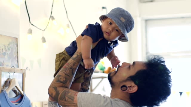 father holding up his son - leanincollection stock videos & royalty-free footage