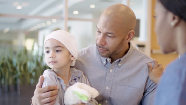 father holding young daughter with cancer - pediatrician stock videos & royalty-free footage