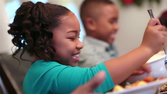 father holds plate while daughter picks and serves herself a carrot - lunch stock videos & royalty-free footage