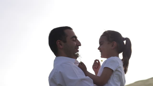 father is spending pleasant time in nature with his daughter - fathers day stock videos & royalty-free footage