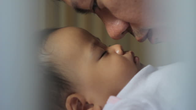 hd : father kiss his baby - genderblend stock videos & royalty-free footage