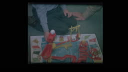 1964 Father kisses son playing Mousetrap board game
