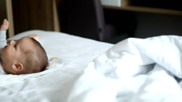 father kissing his baby boy on the bed - modern manhood stock videos & royalty-free footage
