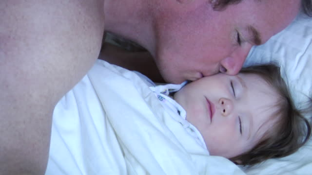 ms father leaning in and kissing baby daughter as she sleeps/ vancouver, bc - see other clips from this shoot 1101 stock videos & royalty-free footage