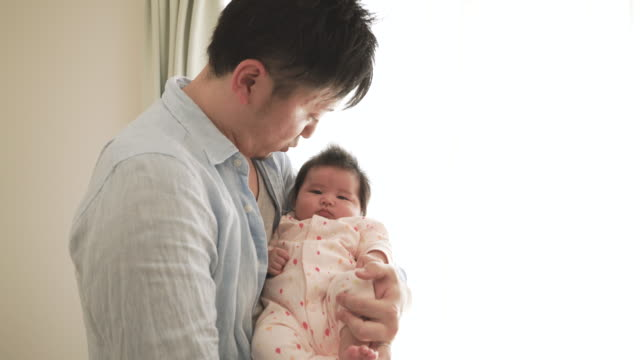 father loving his baby girl at home - genderblend stock videos & royalty-free footage