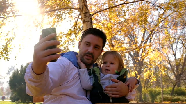 father makes family memories.young father and his son make a selfie - genderblend stock videos & royalty-free footage