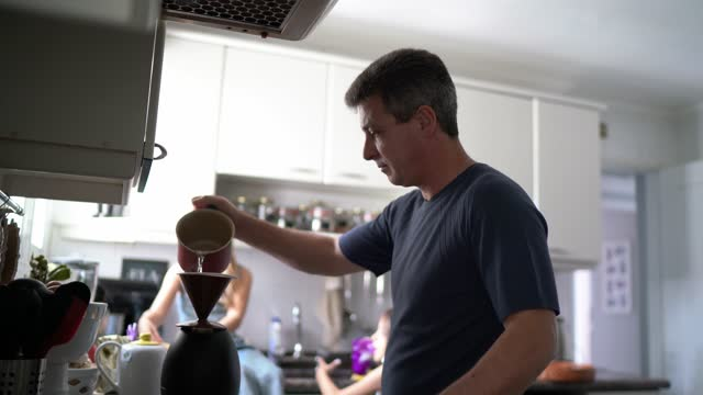 father making coffee with daughters at home - breakfast stock videos & royalty-free footage