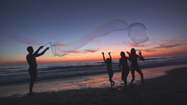 father making giant bubbles on the beach - playing stock videos & royalty-free footage