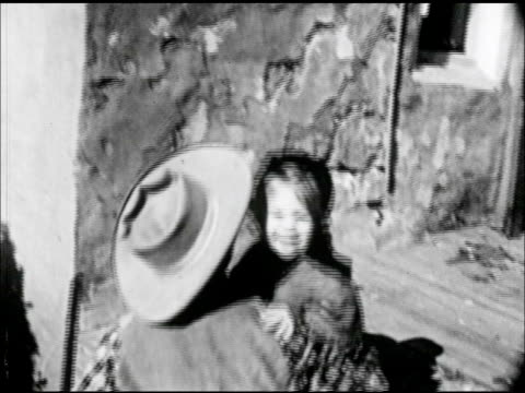 father, male picking up rifle at porch edge, daughter, girl running to father. father handing daughter up to mother on conestoga covered wagon. - westward expansion stock videos & royalty-free footage