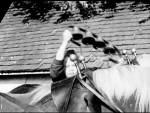 father, male & son, boy hitching team of horse to wagon. boy placing bells over harness of horse. - westward expansion stock videos & royalty-free footage