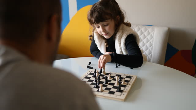 father observing his daughter movements in chess game - dia stock videos & royalty-free footage