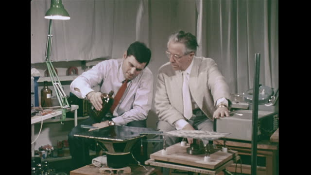 stockvideo's en b-roll-footage met vs father of cymatics dr hans jenny male assistant pouring turpentine on drum membrane vibrating 100 per second forming patterns in liquid dr jenny... - 1972