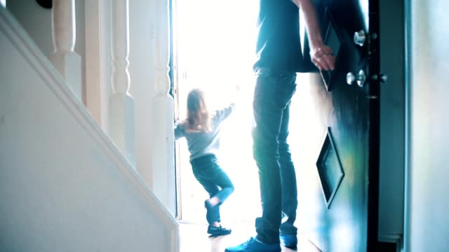 father opens door as his children run outside to play - doorway stock videos & royalty-free footage