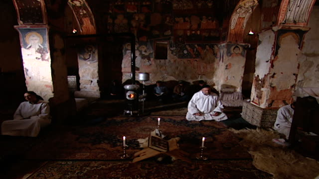 father paolo dall oglio an italian jesuit priest and head of the monastery sits with his clergy in contemplation in the 6th century church - circa 6th century stock videos & royalty-free footage