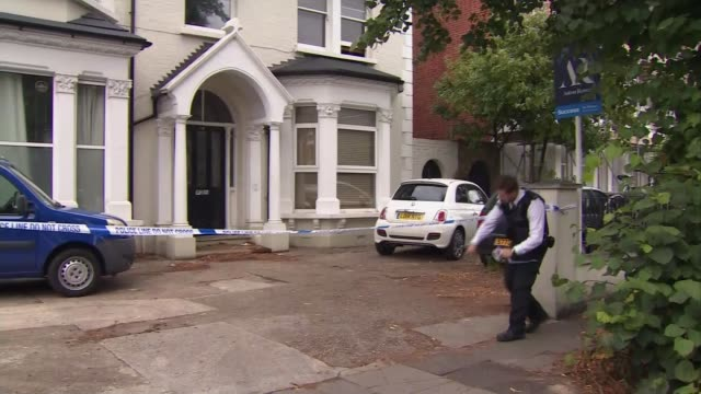 father pays tribute to 10-year-old son after mother charged with murder; england: london: acton: ext police car parked outside house forensic... - crime and murder点の映像素材/bロール