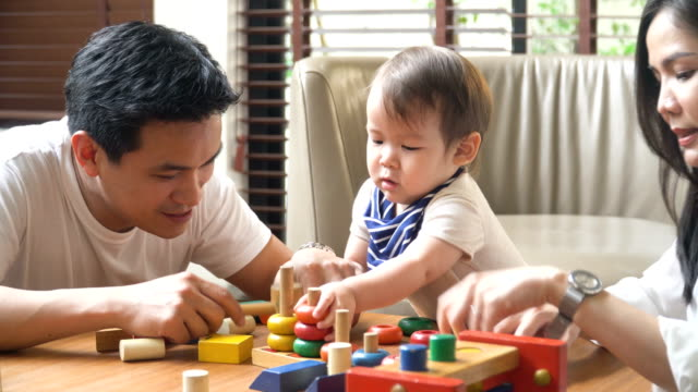 father play with his son, but he is only interested in the toy