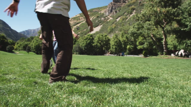 father playing soccer with his daughter - mountain range stock videos & royalty-free footage