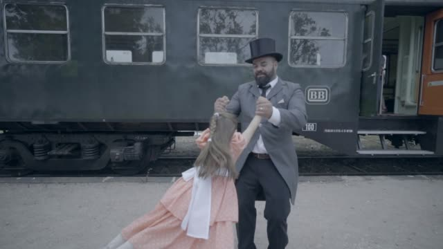 father playing with daughter in train yard - top hat stock videos & royalty-free footage