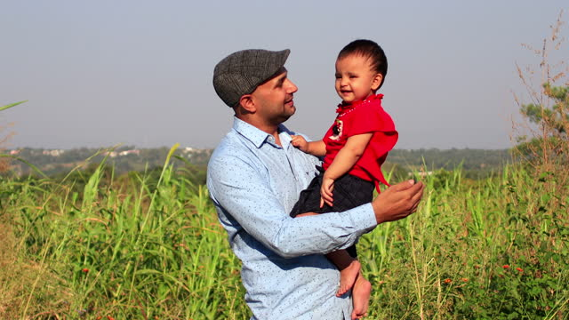 father playing with his baby daughter - sorghum stock videos & royalty-free footage