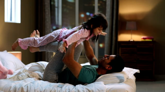 father playing with his daughter at home, delhi, india - swinging stock videos & royalty-free footage