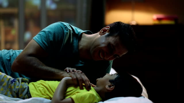 father playing with his son at home, delhi, india - tickling stock videos & royalty-free footage