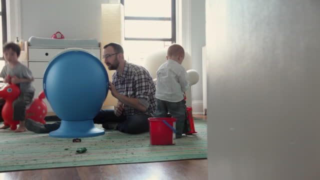 WS Father playing with kids (17 months, 4-5 years) in kids' room / Brooklyn, New York City, USA