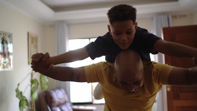 father playing with son at home - human arm stock videos & royalty-free footage