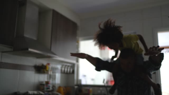 father playing with son at kitchen - humour stock videos & royalty-free footage