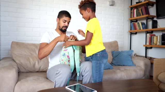 father preparing daughter for school - rucksack stock videos & royalty-free footage