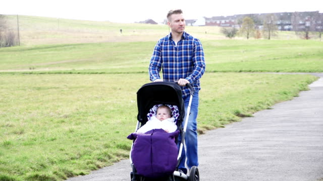 father pushing baby stroller - carriage stock videos & royalty-free footage