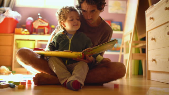 a father reading a tale to his little son. - single parent family stock videos & royalty-free footage