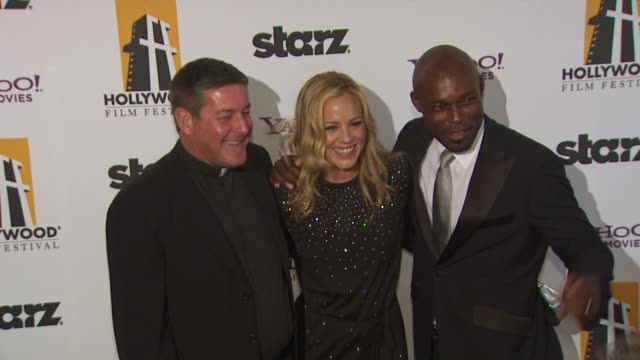 stockvideo's en b-roll-footage met father rick frechette , maria bello , jimmy jean-louis at the 13th annual hollywood awards gala at beverly hills ca. - maria bello